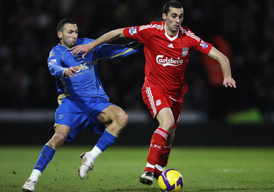 Alvaro Arbeloa of Liverpool is challenged by Nadir Belhadj of Portsmouth