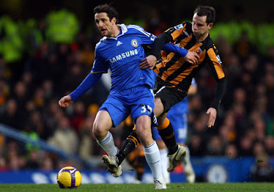 Richard Garcia of Hull City battles for the ball with Juliano Belletti of Chelsea