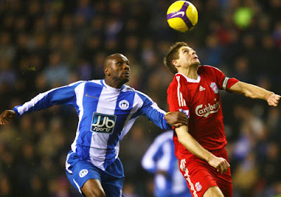 Steven Gerrard of Liverpool battles with Emmerson Boyce of Wigan Athletic