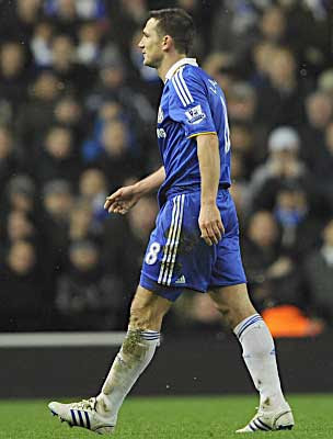 Frank Lampard of Chelsea heads for the dressing room after being sent off against Liverpool on the hour-mark.