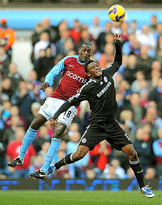 Aston Villa forward Emile Heskey (left) fights for the ball with Chelsea's Nigerian midfielder John Obi Mikel during their English Premier League match at Villa Park in Birmingham, England.