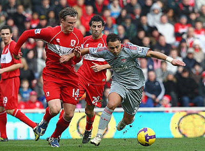 Nabil El Zhar of Liverpool battles for the ball with Robert Huth of Middlesbrough. Middlesbrough beat Liverpool 2-0.