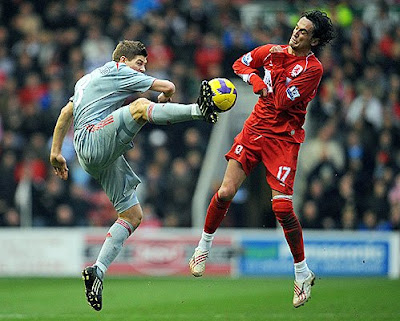 Liverpool's English midfielder Steven Gerrard (left) vies with Middlesbrough's Turkish forward Tuncay Sanli during their match at The Riverside Stadium in Middlesbrough, England, on February 28, 2009.