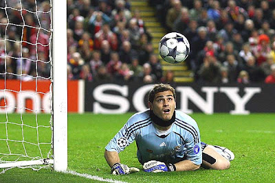 Iker Casillas of Real Madrid watches the ball as he dives to make a save during the UEFA Champions League Round of Sixteen, second-leg match between Liverpool and Real Madrid at Anfield on March 10, 2009 in Liverpool, England.