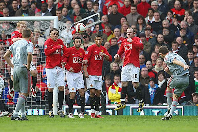 Fabio Aurelio of Liverpool scores his team's third goal. Liverpool won the tie 4-1.