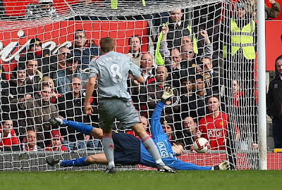 Steven Gerrard of Liverpool scores his team's second goal from the penalty spot.