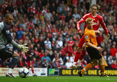 Fernando Torres of Liverpool scores his team's third goal and his hat-trick