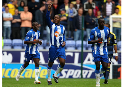 Titus Bramble of Wigan Athletic celabrates scoring