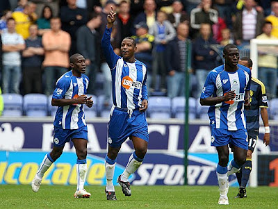 Titus Bramble of Wigan Athletic celabrates scoring during their Barclays Premier League match against Wigan Athletic at the DW Stadium on September 26, 2009 in Wigan, England.