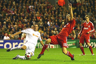 Dirk Kuyt of Liverpool scores the opening goal during the UEFA Champions League Group E match between Liverpool and Debrecen at Anfield in Liverpool, England.