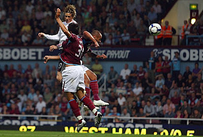 Fernando Torres of Liverpool scores his side's third goal, and his second, against West Ham. Liverpool won the game 3-2.