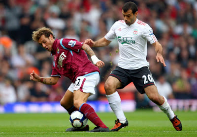 Alessandro Diamanti of West Ham United battles for the ball with Javier Mascherano of Liverpool
