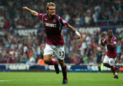 Alessandro Diamanti of West Ham United celebrates after he scored a penalty