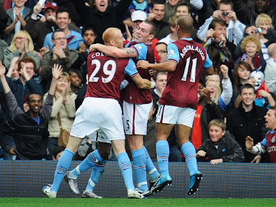 Richard Dunne of Aston Villa (Centre) celebrates with James Collins (29) and Gabriel Agbonlahor (11) after scoring a goal.