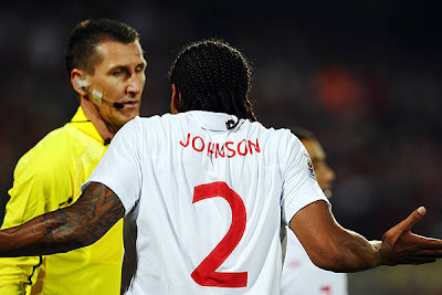 England's defender Glen Johnson argues with Brazilian assistant referee Altemir Hausmann during the Group C first round 2010 World Cup football match England vs. USA on June 12, 2010 at Royal Bafokeng stadium in Rustenburg.