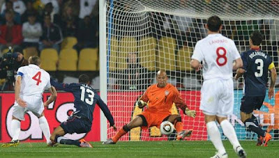 England's midfielder Steven Gerrard (L) scores the opening goal against USA during the Group C first round 2010 World Cup football match England vs. USA on June 12, 2010 at Royal Bafokeng stadium in Rustenburg.