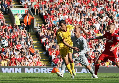 Arsenal's Marouane Chamakh hit a post with the rebound going in off Liverpool keeper Jose Reina