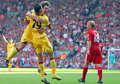 Arsenal celebrate their late equaliser at Liverpool