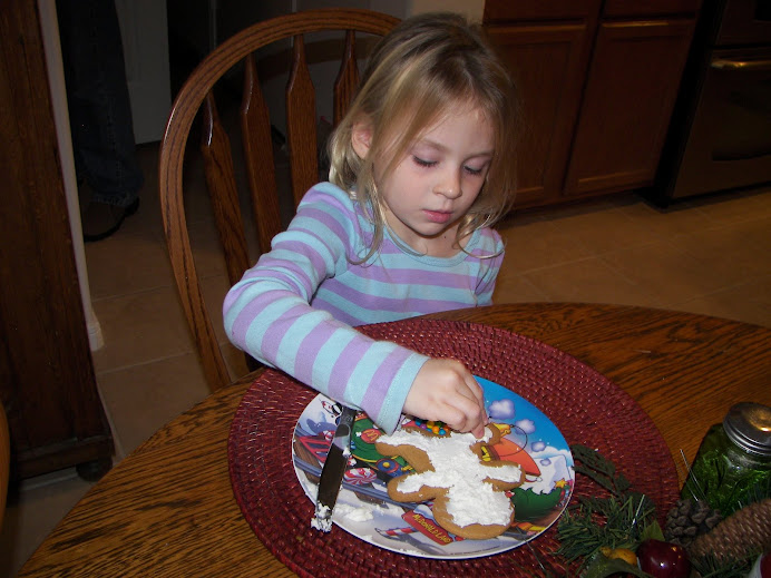 A Decorating Her Gingerbread Man