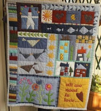 """All we need is love"" baby quilt"
