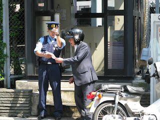 Japanese police officer giving directions.