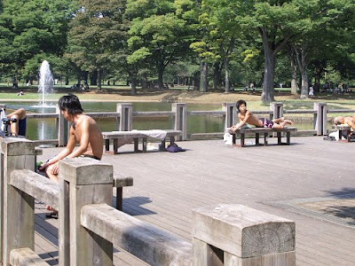 Japanese boys sunbathing in Yoyogi Park, Tokyo.
