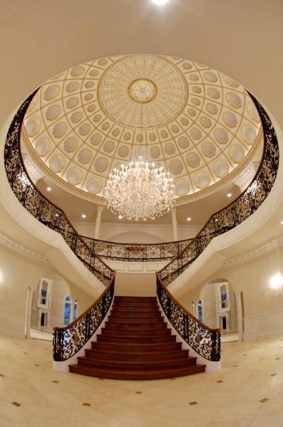 Beautiful double curved staircases from homes of the rich for Luxury staircases