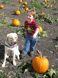 Poppy and Brian with a pumpkin