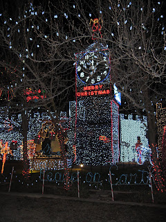 Houses covered in thousands and thousands of Christmas lights. Clock tower, etc