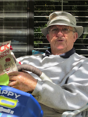 Papa Marks sitting in his chair on the porch with his birthday presents