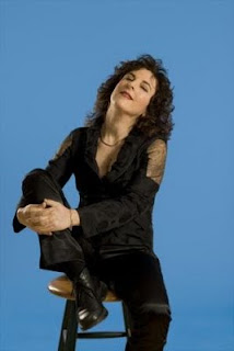 singer-poet Lisa B (Lisa Bernstein) leans back and relishes the moment