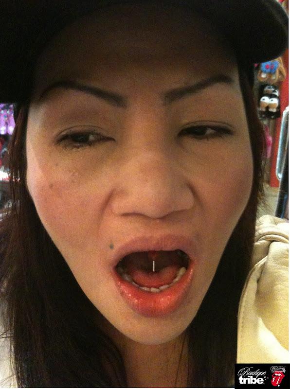 Tongue piercing title=