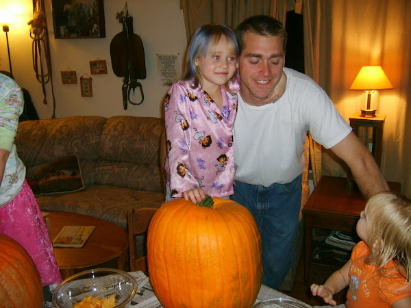 Jenna waiting her turn to pull the guts out of her pumkin