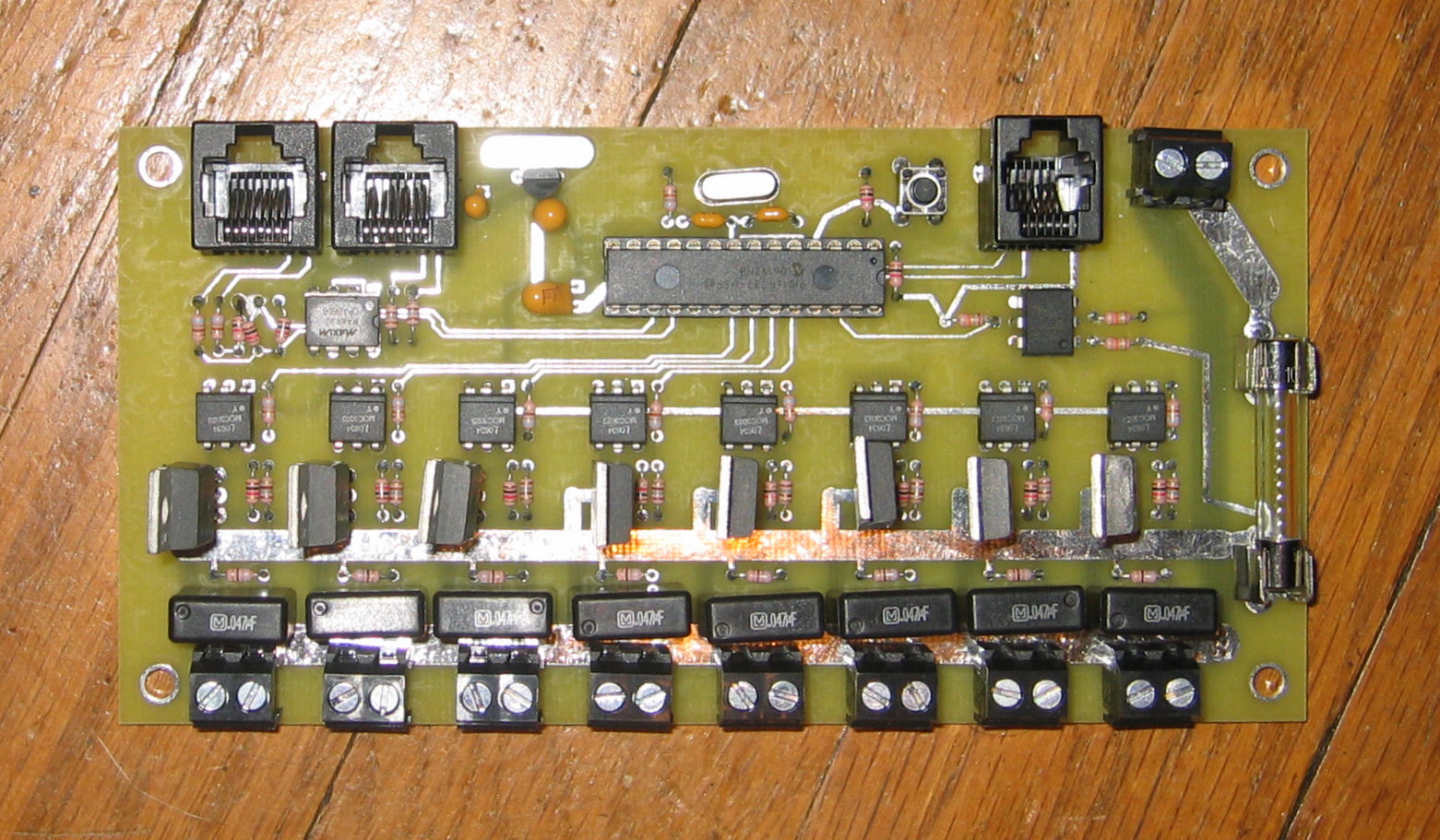 there is one two position terminal block at the bottom of the board for each output ive provided links to the microchip project file the assembly code