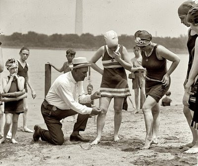 1922 measuring length of ladies swimming costumes