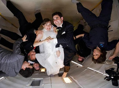 suburban spaceman weightless wedding in zero gravity flight