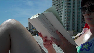 Photograph -Rick van der Valk -Hailey enjoying her book on the beach -Myrtle Beach, SC.