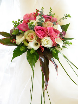 This Hand Tied Wedding Bouquet is created from Pink Ivory Calla Lilies