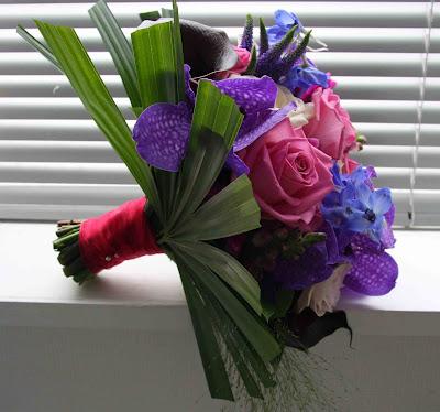 Gemma 39s wedding bouquet includes Vivid Purple Vanda Orchids