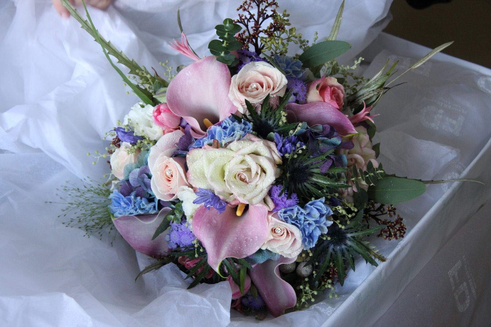 The flower magician ice blue pale pink wedding bouquet for Pink and blue flower arrangements