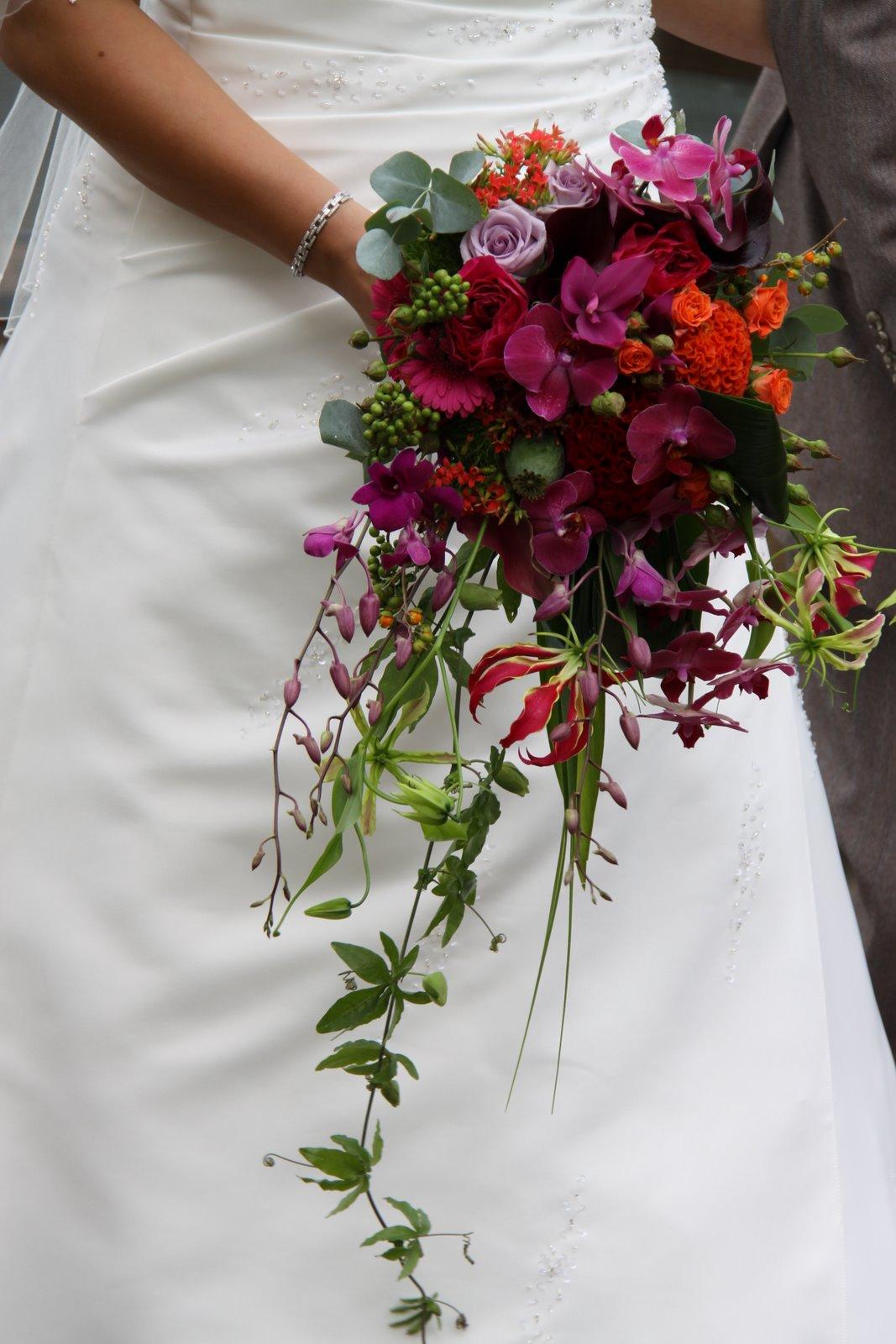 The Flower Magician Vivid Hot Pink Orange Cascade Wedding Bouquet