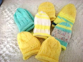 Seven baby hats to give away
