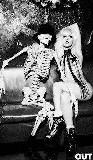 Nearly nude photo of Lady Gaga hanging out on a couch with a skeleton