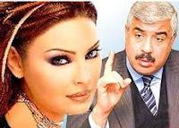 الفنانة القتيلة سوزان تميم مع صورة هشام مصطفى طلعت الذي ينتظر حكماً بالإعدام