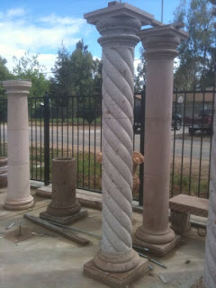 the legs of the metal structure will go into these hollow stone columns