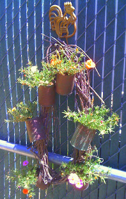 grapevine wreath with tin cans filled with portulaca