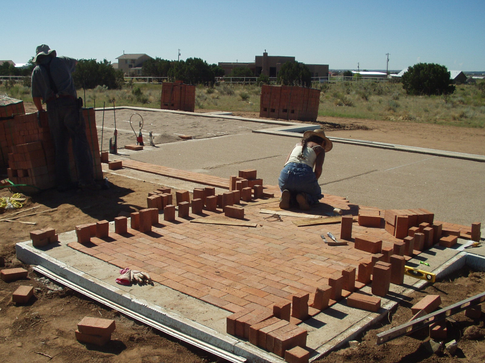 Building our adobe home brick floors started for Adobe home construction