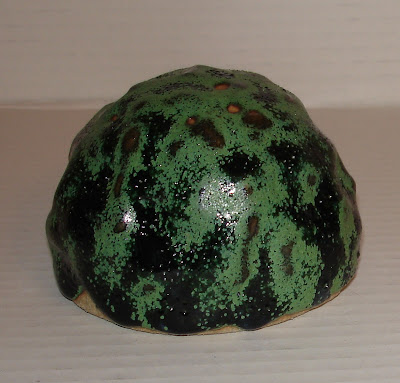 pinched-paperweight-with-green-to-black-satin-matt-glaze