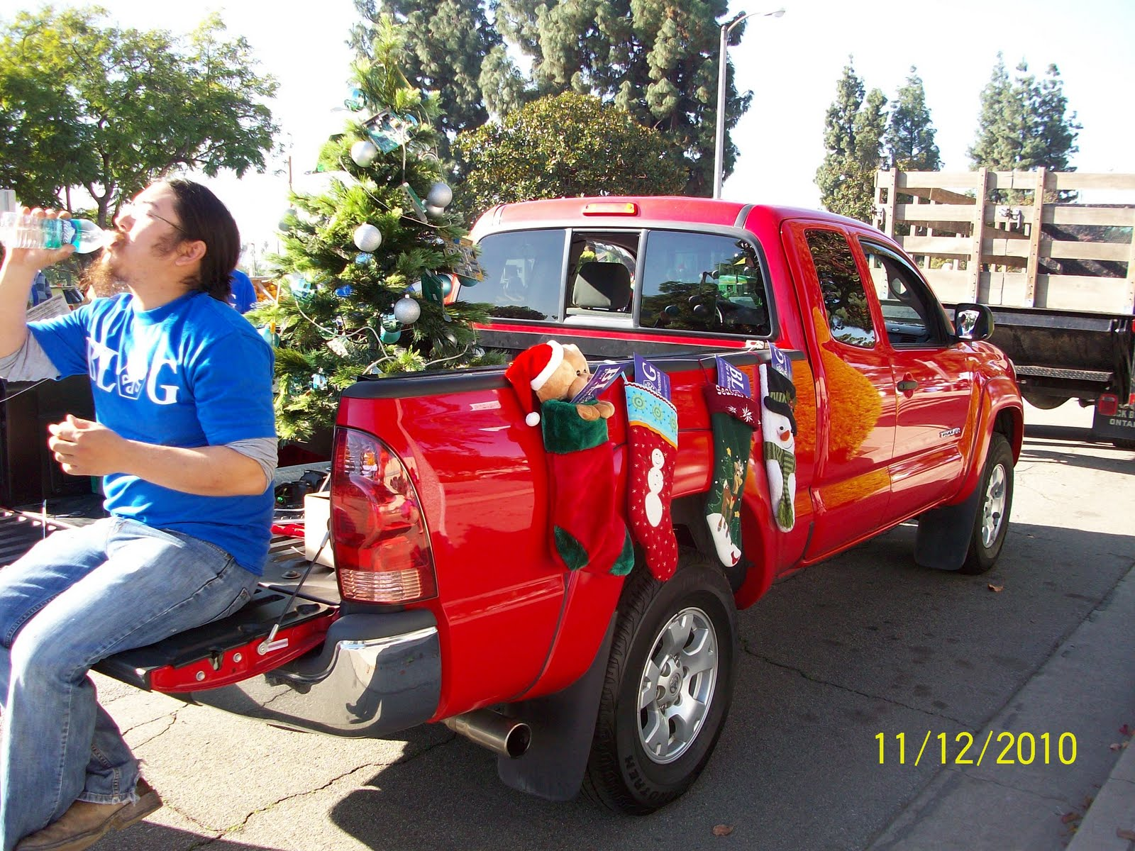 we had a great time at the pomona christmas parade this year the decorated red truck is the pomona bloggers entry my brother drove the truck for us and - Christmas Car Parade Decorations