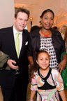 Cameron with wife and daughter...